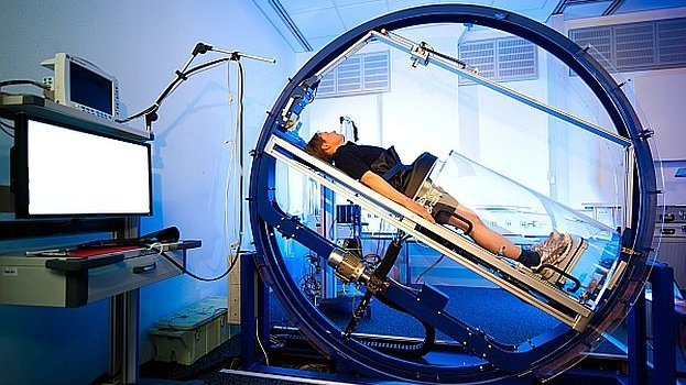 A woman inside a large machine in a hospital.