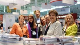 A group of contact persons at a table at the NAFSA.