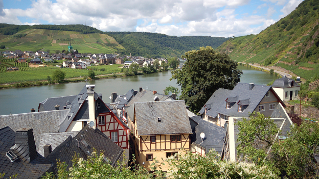View onto old houses, the river Mosel and vineyards in the German town Beilstein.