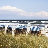 Beach chairs at the beach of the island Ruegen at the German Baltic Sea.
