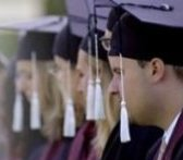 A row of students in academic dress and caps.