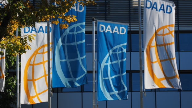 Flags in blue, white and yellow with the DAAD logo seen on them.