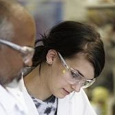 Close-up of two scientists in a lab.