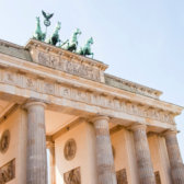 The Brandenburg Gate in Berlin on a sunny day.