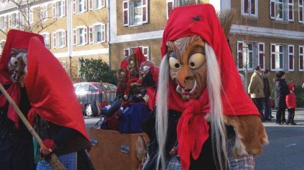 Persons in traditional witch costumes during a German carnival celebration.