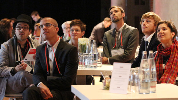 Attendees of a conference listening.