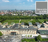 The main building of the University of Cologne, with the university's logo in the upper right corner.